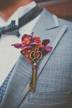 Great idea for a fall vintage wedding.  Attach a key to a boutonniere, like this one found on ruffledblog.com