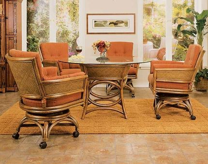 Taipei Rattan Wicker Dining Chair - East meets a more casual Western attitude for dining room seating. The Taipei chair captures Asian elegance in subtle flaring of rattan cane framing at the arms and curved back with arching accents around the circular platform. Wicker panels with their dense fiber patterns will last through a family's daily activities and then provide comfort for entertaining around a game table. A caster base with swivel and tilt functions moves about easily over…