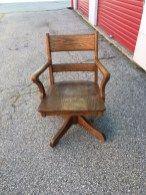 Vintage 1940s oak desk chair – spins, without wheels. Rent through Bygone Theatre, Toronto.