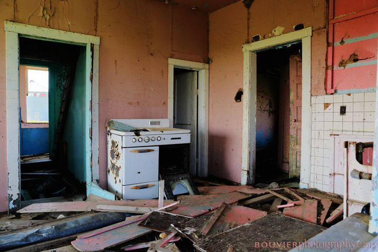 House with a Pink Kitchen | bouvier photography, abandoned house; rural Saskatchewan; rural decay; holes in floor; floor boards; lattice; holes in ceiling; decay; RM of Shamrock; southern Saskatchewan; pink; blue; kitchen; old; rotting; old; interior; broken; dirty; grungy; room; door; aged farm; ruin; damaged structure; spooky; vintage; old stove; destruction; shabby