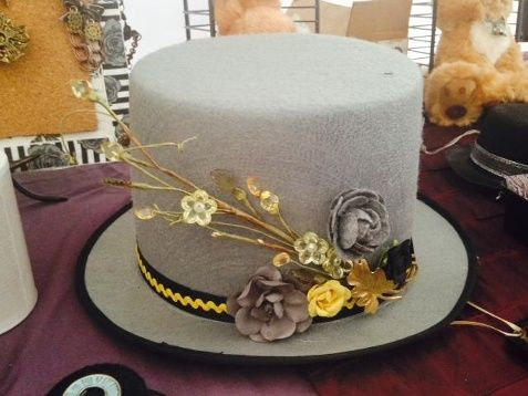 Top hats, popular during the late 1800s and early 1900s, are part of Steampunk dress. (Hat pictured is made byThe Rougish Rabbit.)
