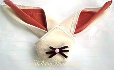 Bunny Napkin Fold, i'd put a couple googly eyes :)