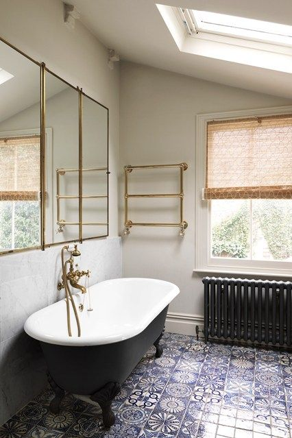 This Victorian house in east London was a typical Eighties conversion, redesigned by Adam Bray to be comfortable and relaxing. The Twenties triptych mirror is gilt metal by Brot, Paris. Moroccan bathroom floor tiles from Habibi Interiors are deliberately mismatched for a patchwork effect. July 2014 issue of House & Garden.