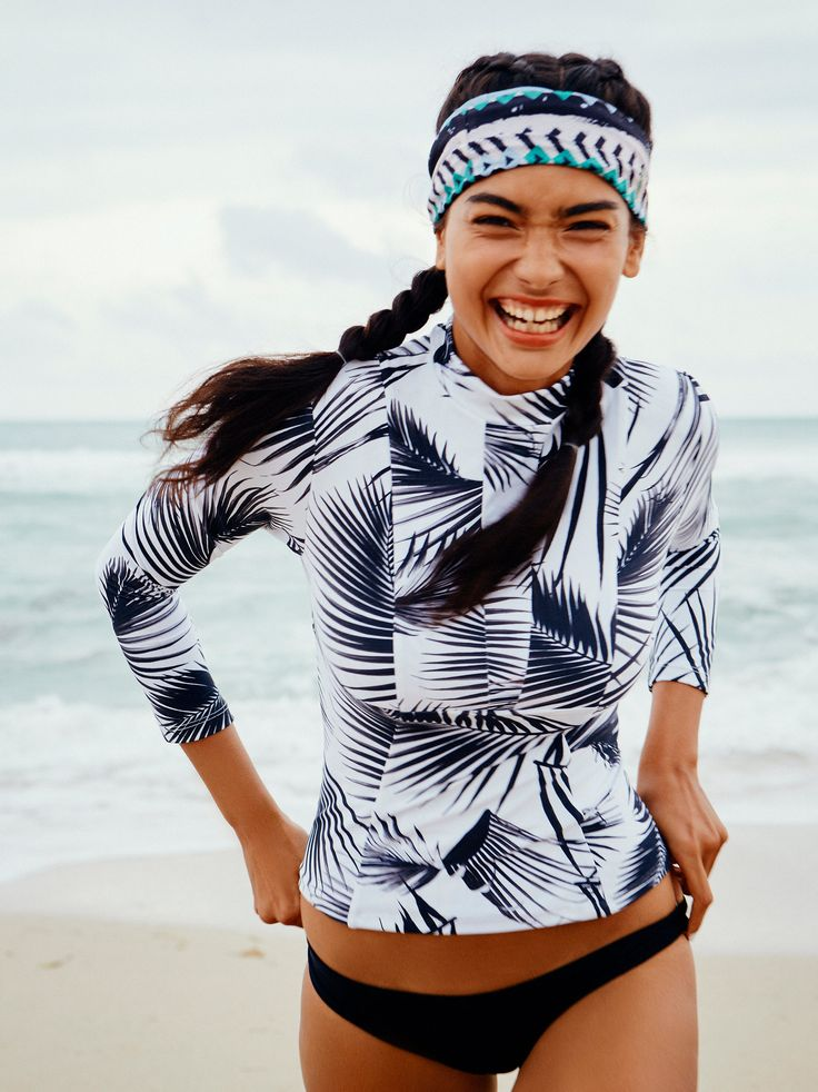Free People  Lowers Rash Guard | In a fun print, this pull-on rash guard features a mock neck and long sleeves. Lined.