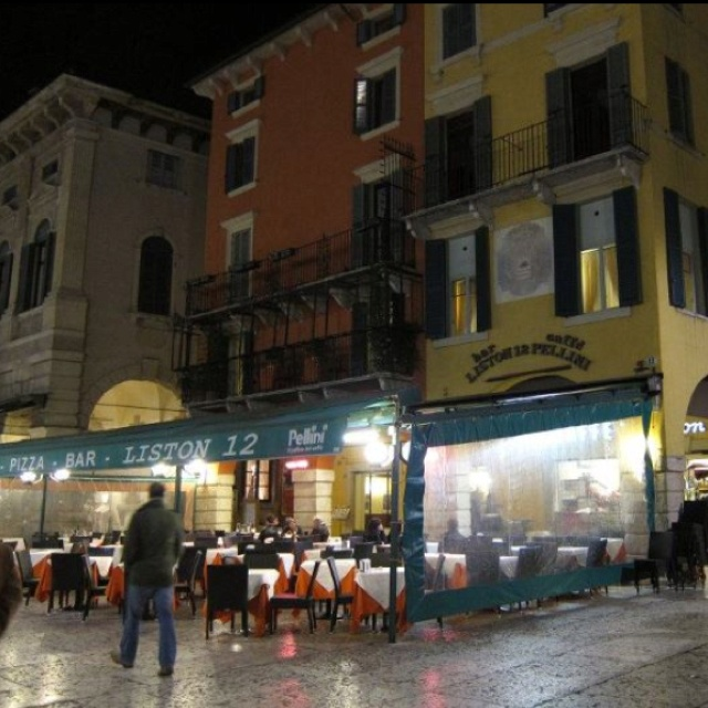 The restaurant we ate at in Verona. Love the limestone streets and shops lit up at night!