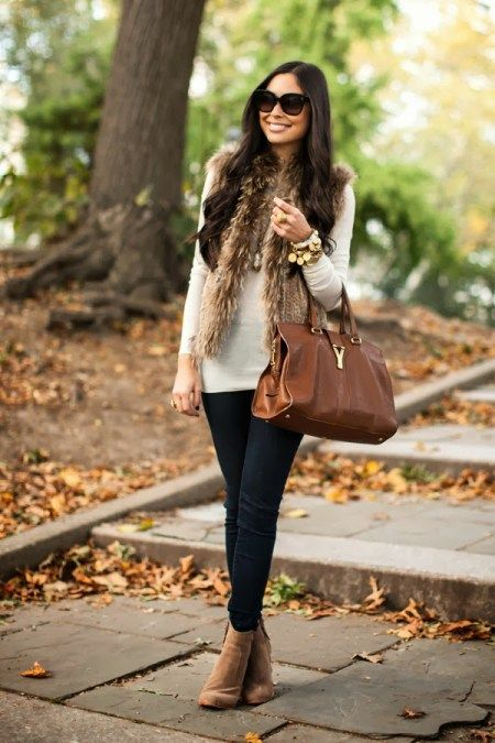 Kat Tanita of With Love From Kat wears a Theory sweater, Belle Fare Fur Vest, Joie Jeans and Joie booties for a fall day in New York City.