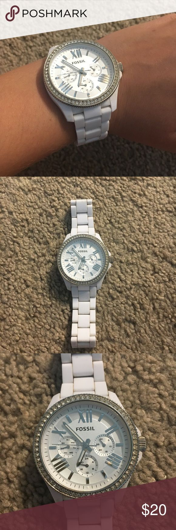 White Fossil Watch with Silver Crystals Has been worn a good amount of times and needs a new battery, but overall it looks fine Fossil Accessories Watches