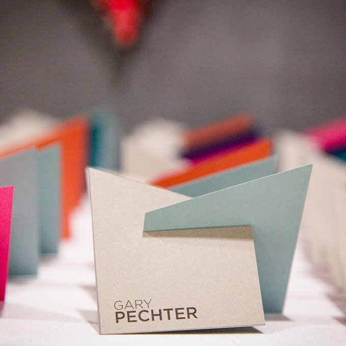 http://Brides.com: . Your modern aesthetic can extend to your escort cards, too. These shapely cards created by 33 West Designs, are perfect for a loft wedding.