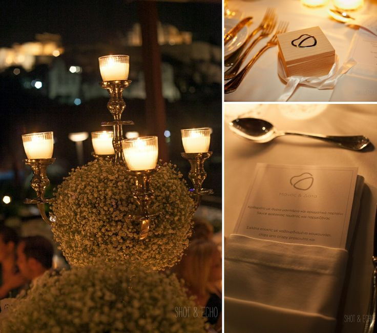 Elegant details of the wedding table!The candelabras decorated with babies breath (gipsofila) flowers, the wedding favor and the menu with the couple's specially designed logo!!!