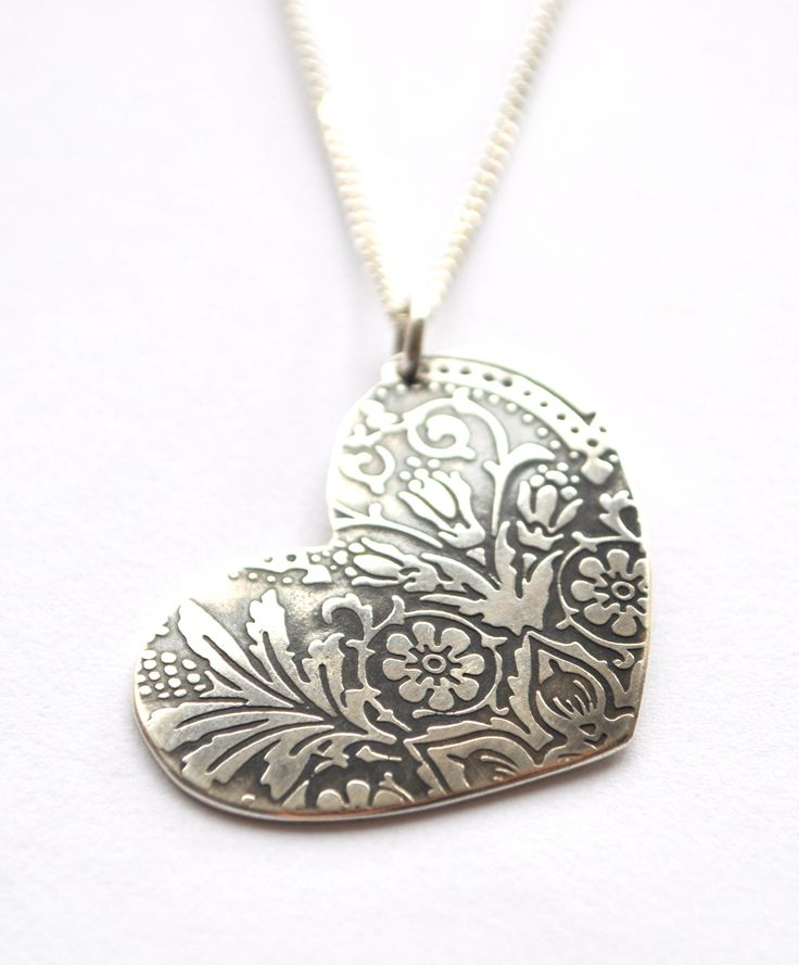 embossed silver heart