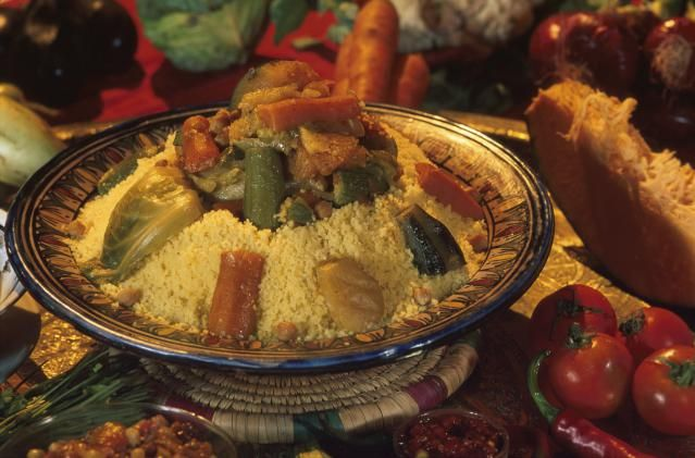 This famous Moroccan dish features a mound of steamed couscous topped by stewed vegetables and meat. Very delicious!