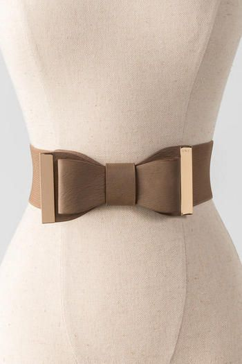 """Dress up your look with a bow!  This adorable taupe belt features a bow that sits front & center with gold hardware. <br><br>    -28"""" length x 2.5"""" width<br>  -Measured from small/medium<br>  -Imported<br>"""