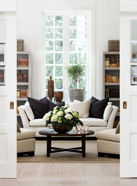 The perfect transitional accents to get your all-white living room ready for fall.