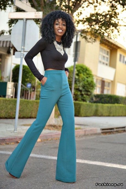 black long sleeve shirt, teal high waisted flared trousers