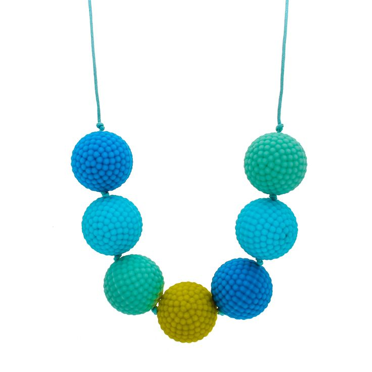Mint and blue, with a pop of lime. Soft nubs for sensory play. Drop 40cm, bead size 28mm.