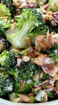Creamy Broccoli Salad ~ full of fresh broccoli, red onion, dried cranberries, sunflower seeds and bacon mixed in a creamy, delicious dressing.