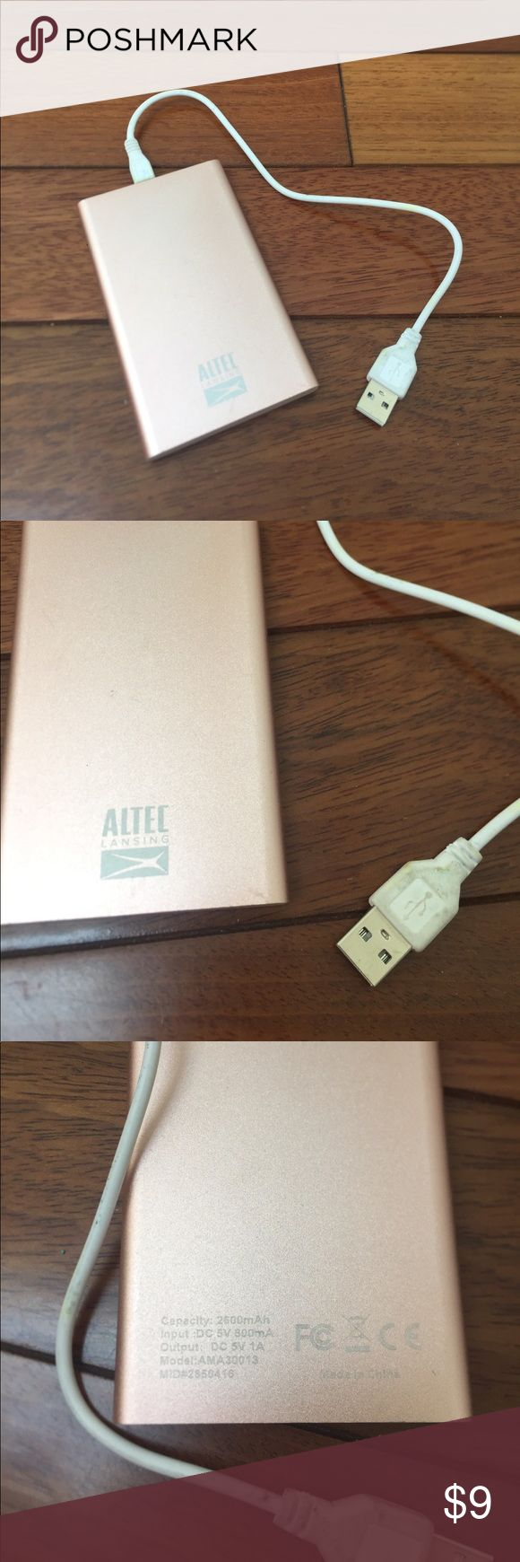 Altee Lansing Metallic Pink Battery Pack Altee Lansing Metallic Pink Battery Pack. Super thin. 2600 mah capacity. Wire a bit dirty. Very thin battery. Surface is slightly scratched up from being in a bag. I've been gifted a few batteries and am getting rid of this one. Altee Lansing Other