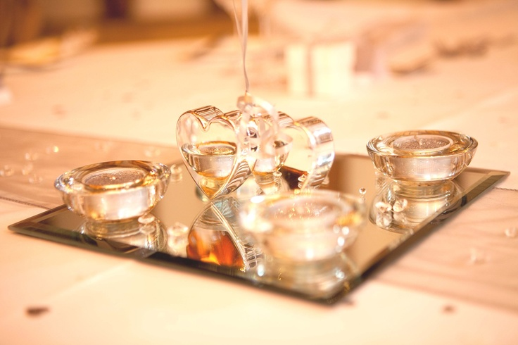 Platinum organsa table runner, with square mirror with silver glitter tea lights in clear tea light holders.  The double heart weight holds a cluster of balloons from www.fschiadesigns.co.uk.