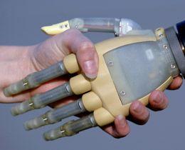 A photo of a bionic and human handshake