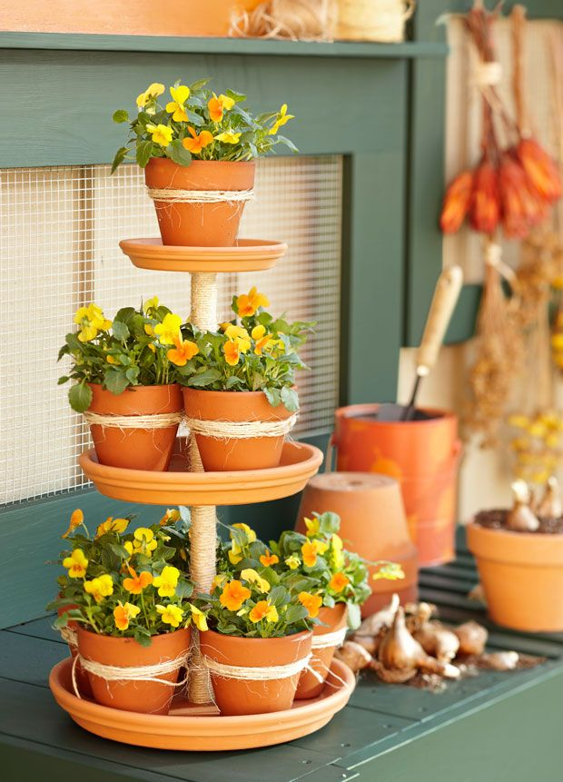 DIY terra-cotta tower~ for plants, kitchen supplies, use as a serving tray for treats, ,jewelry, etc