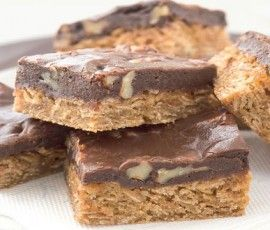 Chocolate Oat Bars: Another NESTLÉ Sweetened Condensed Milk recipe from our 100 years of Sweet Baking Memories Book. Make your own bars for school lunch boxes - they are so easy to make and they taste just great!. http://www.bakers-corner.com.auhttps://www.bakers-corner.com.au/recipes/bars/chocolate-oat-bars/
