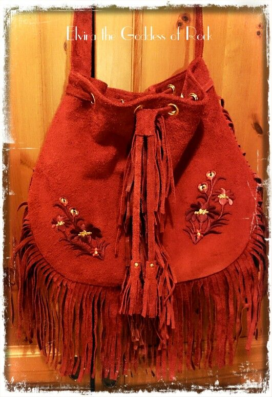 Red suede tassel bag with embroidered detail