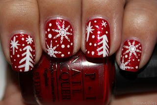 """""""OPI Ali's Big Break, I used 3 coats for full coverage and it applied great. I stamped the snowflakes using BM14 with Konad white,I then used white nail art paint todraw the tree and snow flakes, I dotted with OPI Alpine snow."""""""