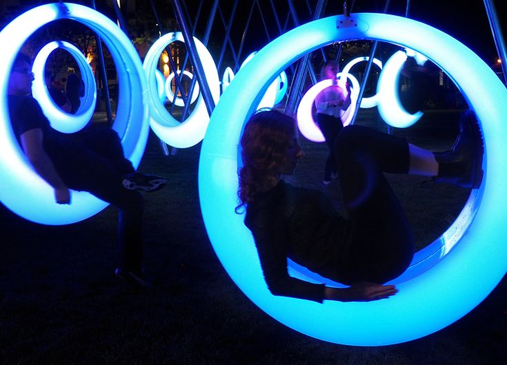 LED lighting within the swings are regulated by custom micro-controllers that signal their activity levels.