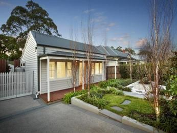 Weatherboard victorian house exterior with porch & landscaped garden - House…