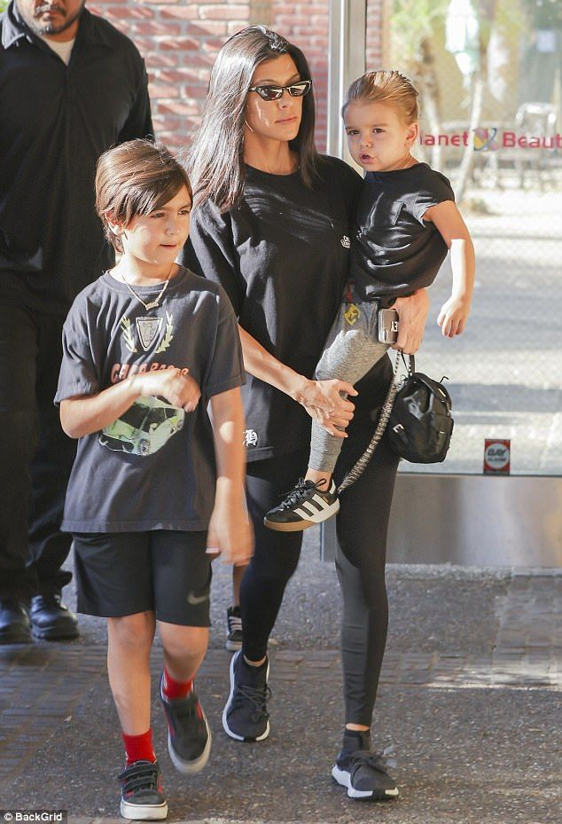 Scott shares three young children with ex-girlfriend Kourtney Kardashian who he dated for nine years on and off until 2015. Kourtney, 38, is pictured with sons Mason, seven and Reign, two last month