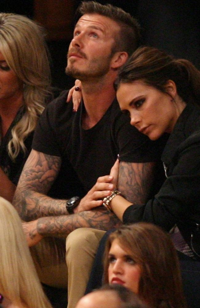 While Victoria doesn't look too interested in the game, she clearly devotes plenty of attention to husband David. And wouldn't you?