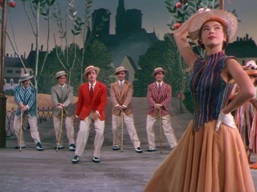 """**An American in Paris (1951) Gene Kelly, Leslie Caron - Director: Vincente Minnelli - Penniless artist sings and dances with French urchins and falls in love in spectacular MGM musical style.  """"Back home everyone said I didn't have any talent. They might be saying the same thing over here but it sounds better in French."""""""