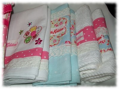 Cath Kidston fabric on decorated tea towels  and label made from the selvage.