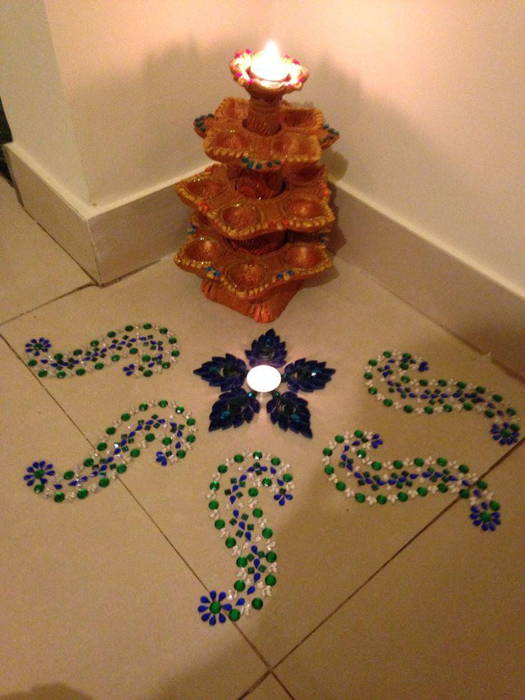 Rangoli...lamp and rangoli embellished with rhinestones