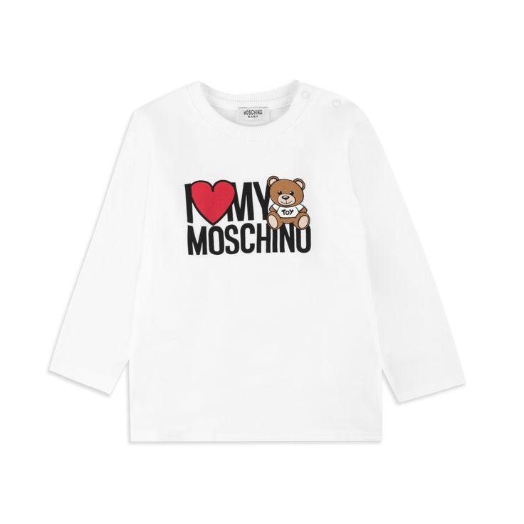 MOSCHINO Baby Girls Teddy Heart T-Shirt - White Baby long sleeve t-shirt • Soft stretchy cotton • Round neckline • Shoulder popper fastening • Teddy heart logo graphic • Material: 95% Cotton, 5% Elastane