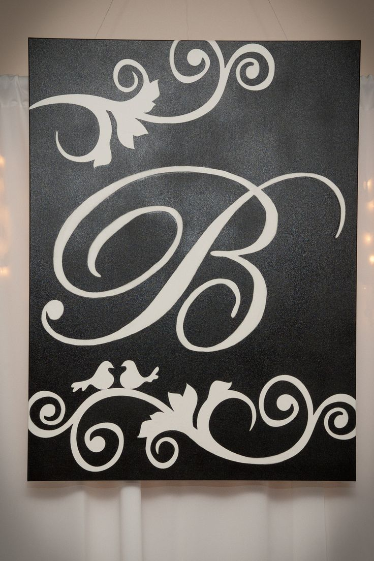 Spray painted monogrammed wedding canvas