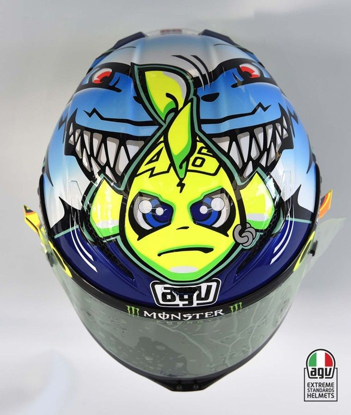Valentino Rossi Shark Helmet (Misano) 2015: Valentino Rossi went into the Misano MotoGP as championship leader, but the gap was closing between Lorenzo.  To reflect the pressure he was under he had a new helmet design that portrayed Rossi as a tiny yellow fish being chased down by a huge shark.