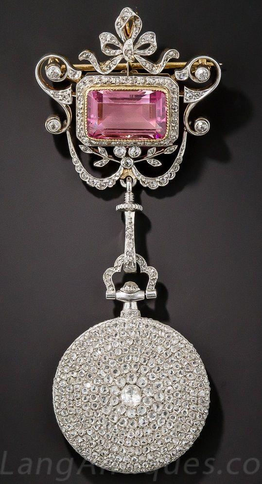 Cartier Diamond Pendant Watch with a Pink Tourmaline Surmount, 1920's