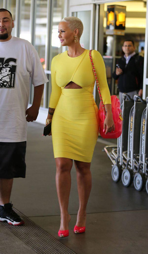 House Of CB 'Carelle' Yellow Front Cut Out Long Sleeve Bandage Dress, Moschino Hot Pink Inflatable PVC Shoulder Bag, and Giuseppe Zanotti Neon Pink Patent Leather & Denim Mules