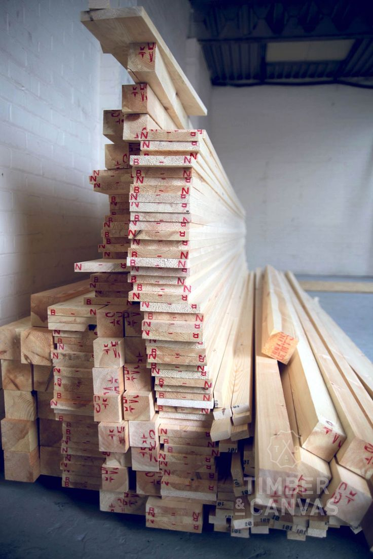 Precariously stacked timber (Swedish Redwood) ready to use in our workshop.
