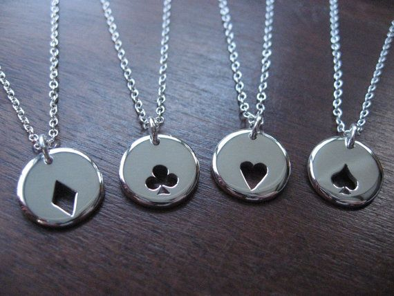 Four Playing Card Suit Charms Silver Necklaces Pendants. £80.00, via Etsy.