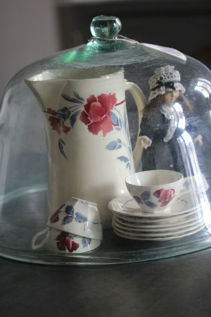 antique doll and Digoin pottery glass cloche