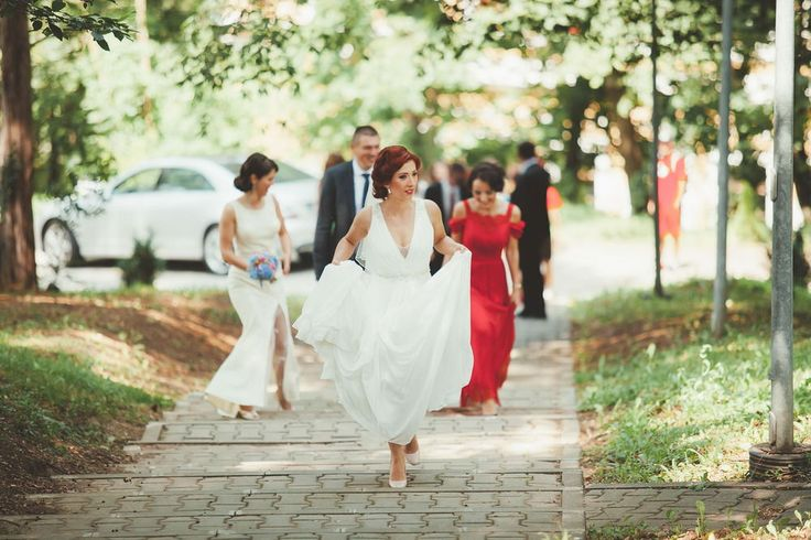 Bride and guests dancing on the brick road amidst the woods