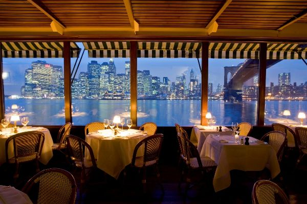 The River Cafe; New York - The River Café's unique perspective at the base of the Brooklyn Bridge provides an unsurpassed silhouette of lower Manhattan.
