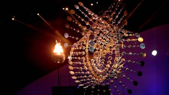 """<p><strong>STUNNING AND SUSTAINABLE WORK OF ART</strong><br> Crowning the Rio 2016 Olympic cauldron is a kinetic sculpture by US artist Anthony Howe. <br> <br> The dynamic and sustainable work of art represents the sun and moves with the power of wind. The artist's vision is that these two renewable energy sources should be more widely exploited.<br> <br> """"Our cauldron is a hybrid that moves itself through the wind and reflects fire,"""" said one of the three directors, Andrucha Waddi..."""