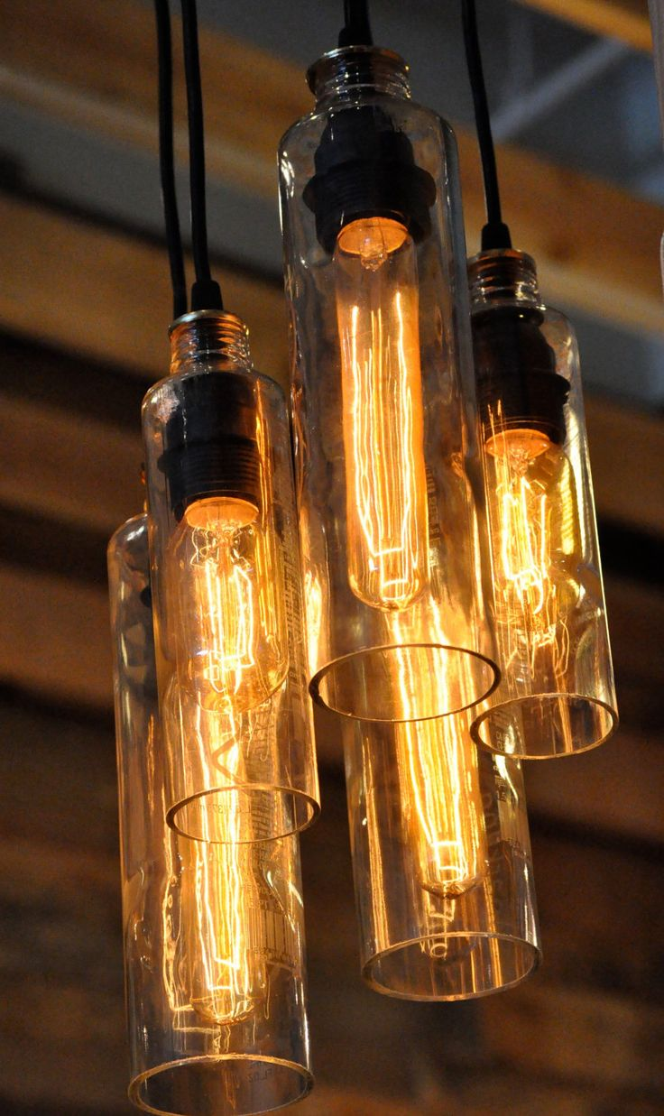Recycled Bottle, Voss Bottle Pendant Lamp, Whiskey Bottle, Hanging Bottle, Hanging Lamp, Bottle Lamp with Edison Lightbulb. $219.00, via Etsy.