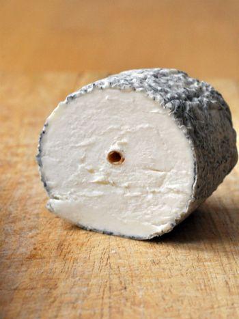 ✿ڿڰۣ   Sainte Maure de Touraine is a French  unpasteurized cheese made from full fat goat's milk. It has the form of a small log, around 16–17 cm in length, and weighs at least 250 g. It is white and soft under a greyish mouldy rind. It has a straw through its centre, marked by the AOC seal and a number indicating the producer. The straw is used, in the making, to keep the roll together. The finished cheese has 45% milkfat. It has a balanced tang with walnut notes and a lemony finish.