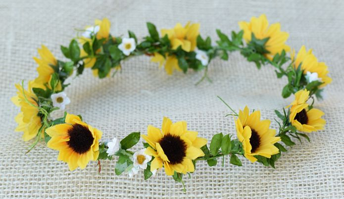 Each crown has mini yellow sunflowers and sweet little white daisies.  This crown is open in the back, so you can tie the ends together with ribbon, or use bobby pins to secure into hair for the perfect fit.