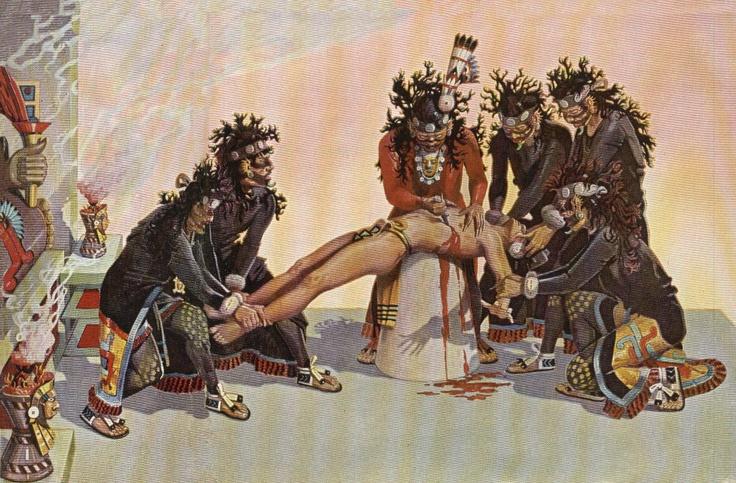 Aztec priests conducting a human sacrifice.