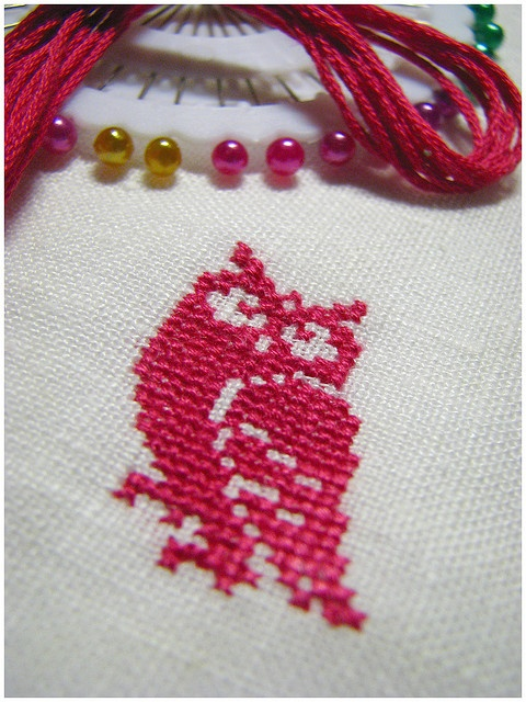 Pink cross-stitch owl by gnilp, via Flickr